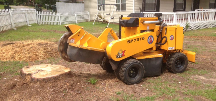 Tree stump removal with a grinder in Millbrook, Alabama