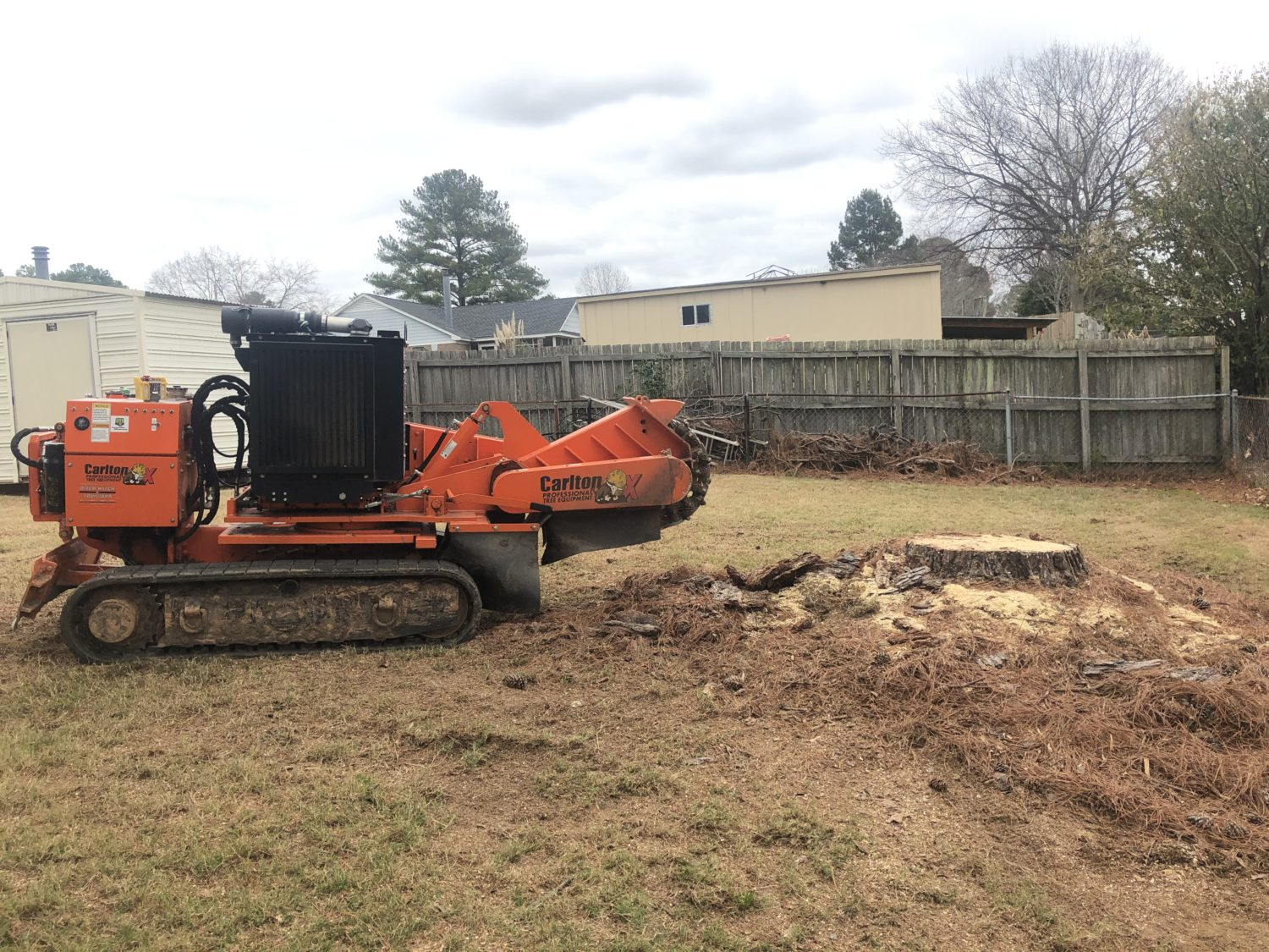Grinding a stump and the surrounding roots and mound in a backyard in Millbrook, AL